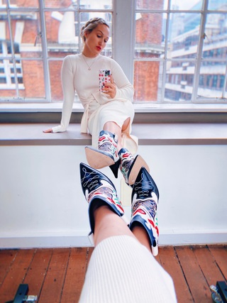 Sophia wearing her Shelby Cone Heel Boot by Sophia Webster